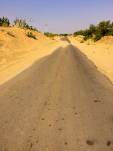 Roads with sand almost covering them